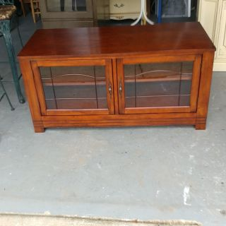 Beautiful Entertainment Cabinet. Glass Doors and 4 Shelves. Restained and Polished. 50x22x25