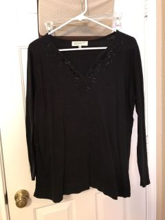 Women's black top with black shiny things . Size 1X. $4