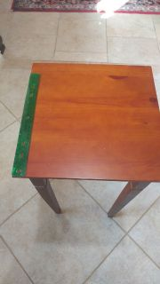 Square brown wooden table