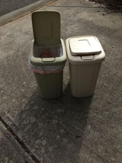 Two 5 gallon trash cans