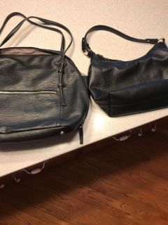 2 black leather bags
