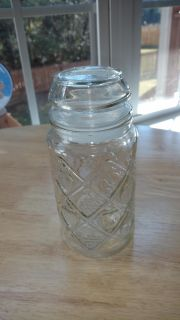 """Glass container with airtight lid measures 7 1/2"""" tall"""