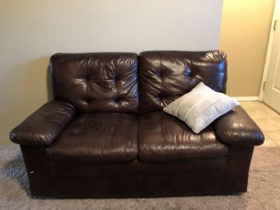 Brown couch and love seat
