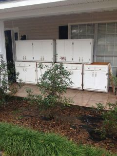 2 upper cabinets and 4 base cabinets . All wood