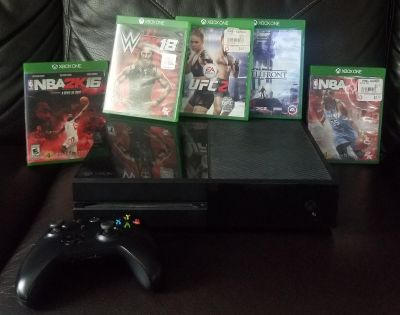 Xbox One with 5 games ( plus 2 games downloaded into the system)
