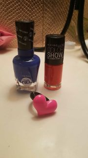 Two nail polishes and a ring