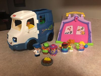 Little people talking camper and tent