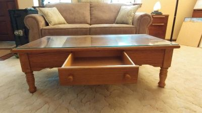 Like new solid wood coffee table with glass top