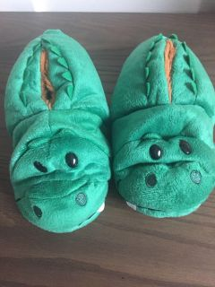 Flip-a-zoo slippers. New. Size 12