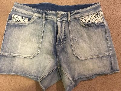 Cute frayed look light denim shorts size 18. Somewhat stretchy