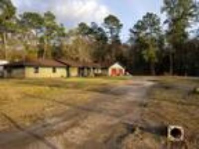 3.0 acres with large Four BR 2bqth home that needs to be fixed.