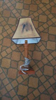 Small lamp shade is torn on one side 5.00
