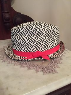 Black print hat with hot pink bow. In nice condition.
