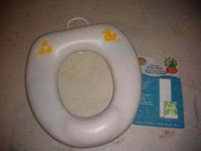Potty seat with hanger