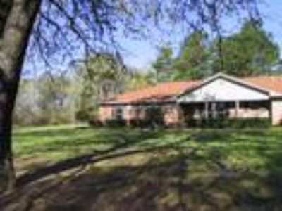 East Texas Dream home with pool, spa and acreage!