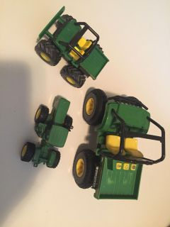 Three John Deer toy tractors ATV. Two are die cast. Meet or ppu in Gallatin.
