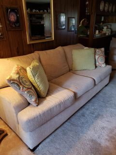 Beige couch and love seat