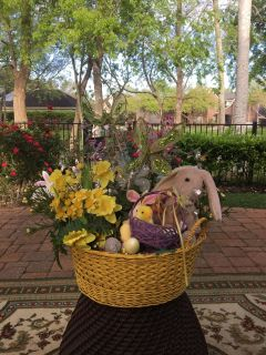 Decorative Easter basket filled with bunnies, butterflies, flowers and light-up eggs.