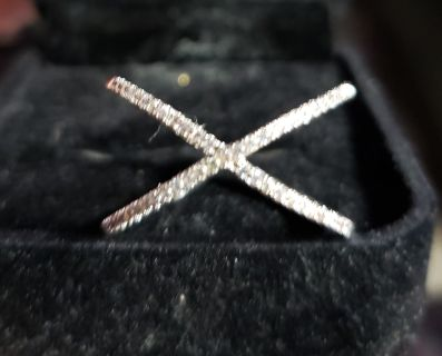 Crisscross Crystals set in white goldtone . Size 8