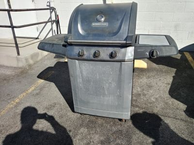 Stainless steel BBQ with side burner and propane tank