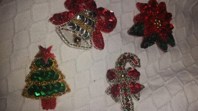 Christmas decor. Pins on back. Not sure of age