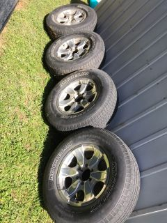 Tires and rims and also have center caps