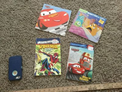 Set of 4 soft cover books, $2.00 takes all. Disney Cars, Monsters inc, Spider-Man. Normal wear on covers.