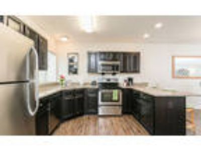 Auburn Creek Apartments - Three BR, Two BA 1,422 sq. ft.