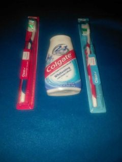 Colgate toothpaste and 2 toothbrushes