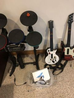 Nintendo Wii with games, guitars and drums