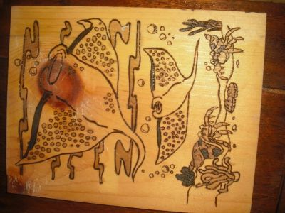 hand burned and stained ray picture on reclaimed wood