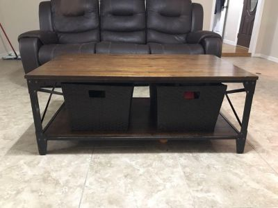 Coffee table with two baskets.