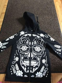 Zip up hoodie- tag says medium- fits more like a small