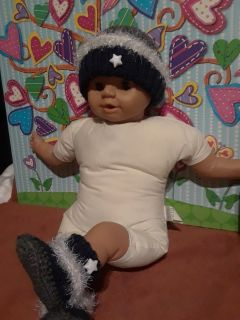 Crochet/knitted baby booties and beanie