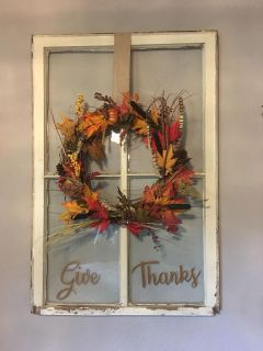 Fall handmade wreath on old vintage window sash with words Give Thanks