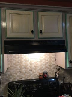 Black above range hood and light by Broan - 3 years old
