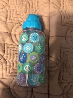 Water bottle with straw and flip top