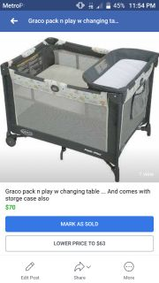 Pack n play w changing table and sheets and storge bag