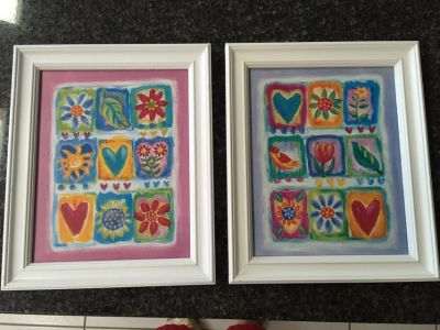 Two white framed Hearts & Flowers pictures
