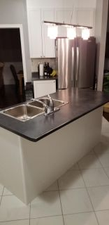 Kitchen counters with sink and tap