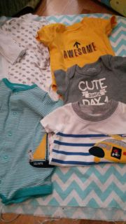 Set of 7 onesies and outfit. Some never worn