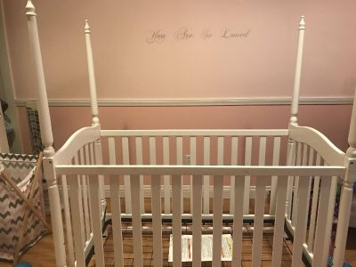 White crib w flowers and poles