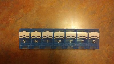 2xl weekly pill planner . contoured design . asking 3.50 .