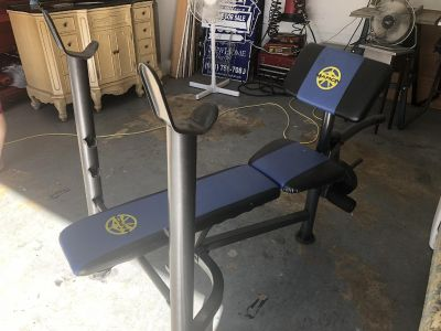 weight bench with 55 lb weights.