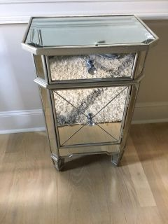 Mirrored bed stand