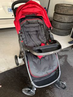 Stroller with on board car seat.