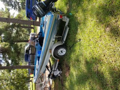 Boat 15 ft avenger bass boat and trailer