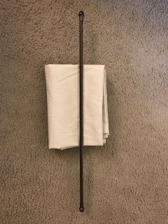 Beige blackout curtain and rod