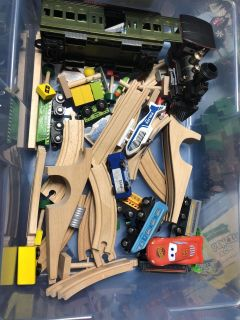 Random mix of wood trains , tracks and carrying case