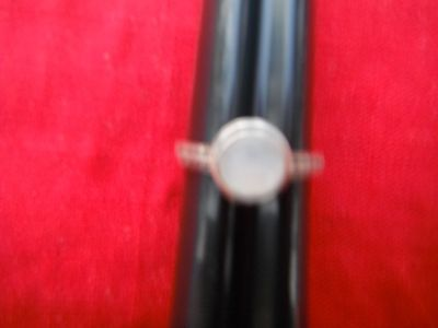 Ladies Silver ring,size 10, w/moon stone and 5 small red saphires on either side